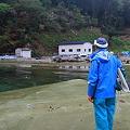 写真: 地盤沈下の漁村